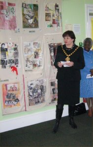 Councillor Judith Warner, with the 'quilt of memories' in the background