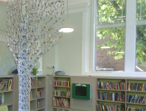 The light and airy jewelled trees reflect the trees outside the window at Queen's Park Library