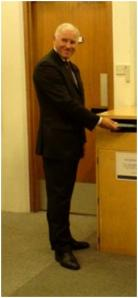 Cllr Melvyn Caplan demonstrates the self-service facilities at the Express Library