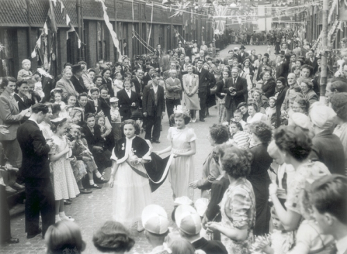 View of scene in St John's Wood during Royal Drive through by Queen Elizabeth II and Prince Philip as part of coronation celebrations. Image property of Westminster City Archives.