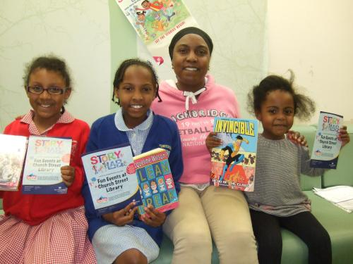 Jackie Clauzel with daughters Kyah and Jada, and neice Rachel at the Story Lab launch in Church Street Library