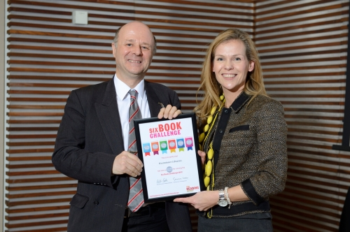 Westminster Libraries' Learning Support Librarian Laurence Foe receiving the award from bestselling author Adele Parks.
