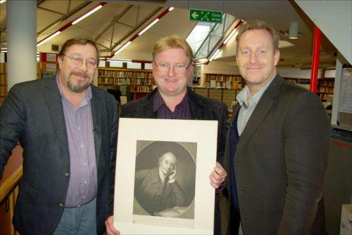 Adrian shows James & Adam Price a portrait of their ancestor Thomas Price