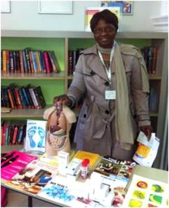Aderonke Kuti with diabetes information at Queen's Park Library, June 2013