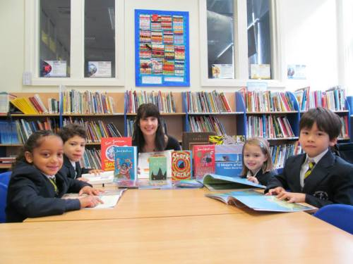 Leah and pupils from St Clement Danes Primary School with their free books!