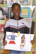 Ibrahim, 10, has chosen to make a collage from fashion magazines