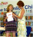 Six Book Challenge, Westminster 2014. Kingsway student Elena-Ramona Potoroaca receives her award from Guest of Honour Davina Elliott