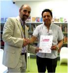 Six Book Challenge, Westminster 2014. Luigi presenting Justo Pastuna Tipan with his award