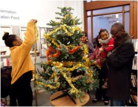 Dressing the tree at the Paddington Library Christmas Fun Day, December 2014