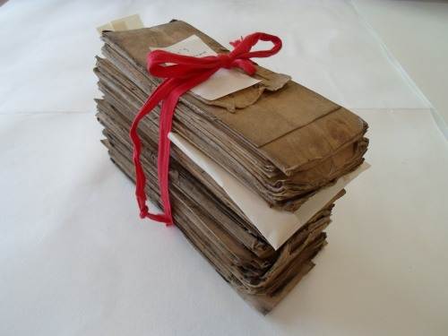 Bundle of St. Margaret's Parish records (E3339/1801) waiting to be cleaned.