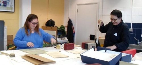 Alison and Jelena repairing theatre programmes at Westminster City Archives
