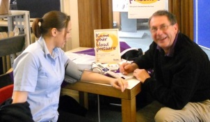 Checking blood pressure at the Victoria Health & Volunteering fair, May 2015