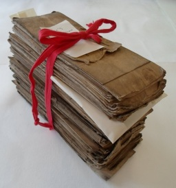 Bundle of St. Margaret's Parish records (E3339/1801) waiting to be cleaned. Particularly vulnerable items are enclosed in archival rag paper for protection.