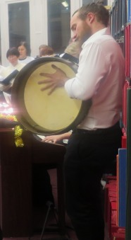 Ruairi Glasheen on the bodhran - Joint Force Singers Christmas Concert at Westminster Music Library, December 2015
