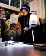 Reading out a clue to 'Florrie Armstrong' - Queen's Park Library sleepover, December 2015
