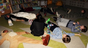 'Florrie Armstrong' shows how to make snow angels - Queen's Park Library sleepover, December 2015