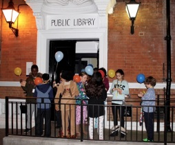Gathering outside the library to release balloons - Queen's Park Library sleepover, December 2015