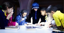 Reading letters with 'Florrie Armstrong' - Queen's Park Library sleepover, December 2015