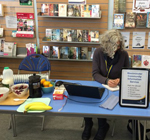 Debra on the Community Information stall in Paddington Library