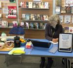 Debra on the Community Information stall in Paddington Library