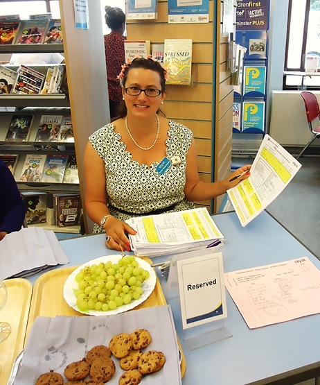 Amber the walk guide promoting her walk in Paddington Library, July 2016